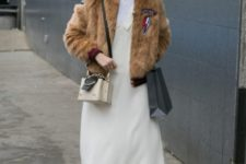 With white dress, mid calf boots and mini bag