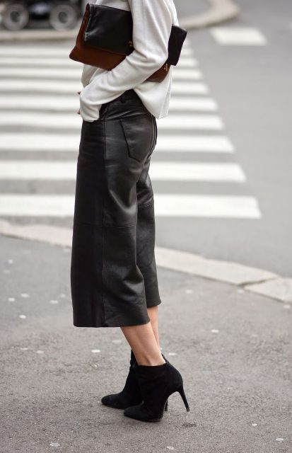 With white loose shirt, black ankle boots and brown clutch