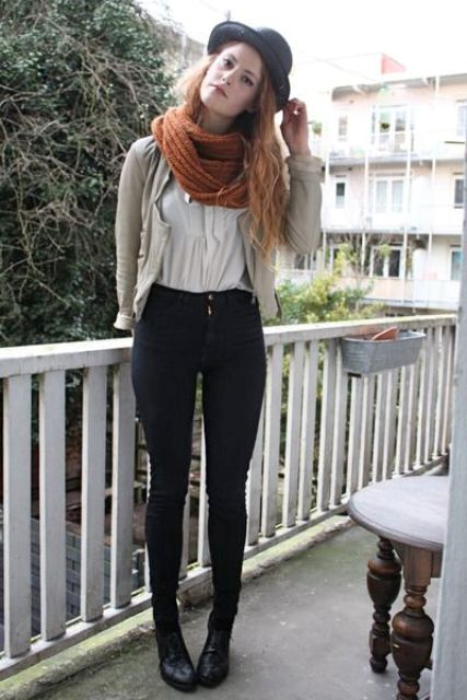With white shirt, black skinny pants, boots and gray blazer