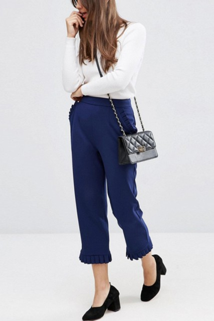 With white shirt, black velvet shoes and crossbody bag