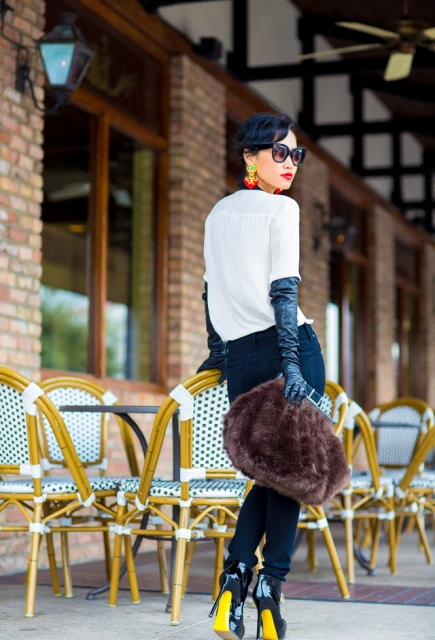 With white shirt, jeans, fur clutch and heels
