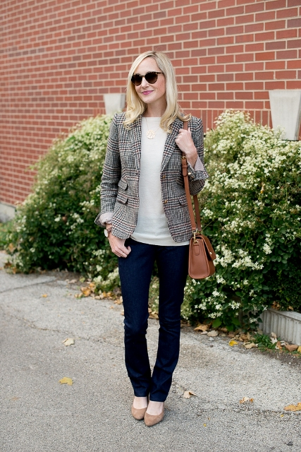 With white shirt, navy blue pants, beige flats and brown bag