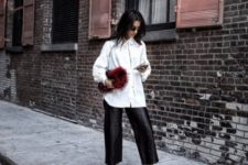 With white shirt, printed shoes and fur clutch