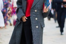 With white shirt, red sweater, black pants, boots and gray maxi coat