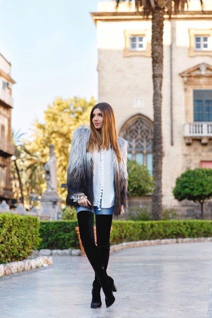 With white shirt, skinny jeans and high boots
