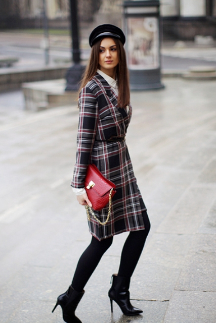 With white shirt, skirt, black tights, black ankle boots, red clutch and black cap