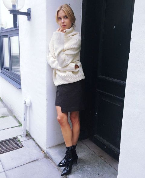 With white sweater and black wrap skirt