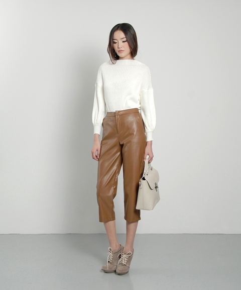With white sweater, beige ankle boots and beige bag