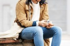 With white sweatshirt, cuffed jeans, suede boots and parka coat