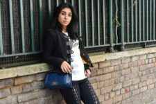 With white t-shirt, jacket, flats and blue bag