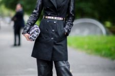 With white turtleneck, black coat and printed clutch