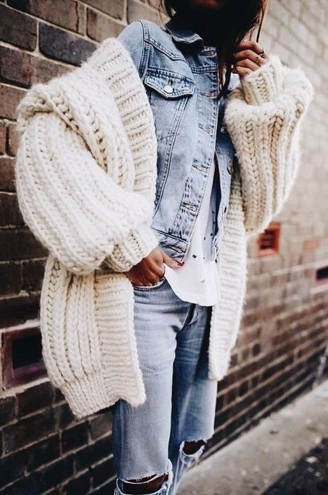 a denim on denim look with ripped jeans and a denim shirt, a creamy chunky cardigan