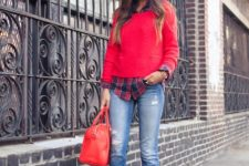 02 a plaid shirt, a red jumper over it, ripped jeans and leopard shoes