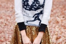 02 a printed ski sweater over a plaid shirt, a gold sequin skater skirt and black tights