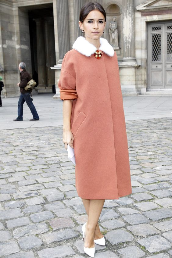 a whimsy terra cotta midi coat with a straight silhouette and a white faux fur collar