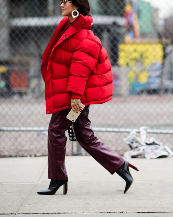 an oversized red puffer jacket is a hot statement this winter