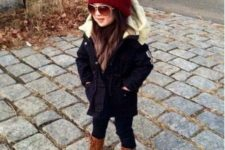 03 a black parka with white faux fur looks super chic with a red beanie