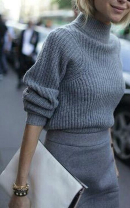 a chunky knit grey sweater and a grey pencil skirt for a work look