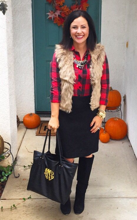 a plaid shirt, a faux fur vest, a black knee skirt, black suede boots