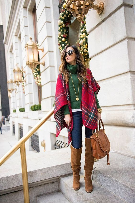 a white tee, an emerald turtleneck sweater, jeans, a plaid pashmina and brown suede knee boots