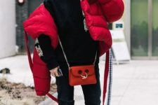 03 an oversized red puffer jacket worn with jeans and a hoodie for a comfy winter look