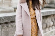 04 a blush winter coat with a faux fur collar for a girlish winter look