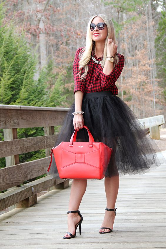 a plaid shirt, a black tulle skirt, black shoes and a red bag