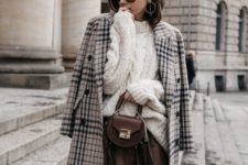 04 a white chunky knit sweater, a brown leather mini, tights, a plaid coat