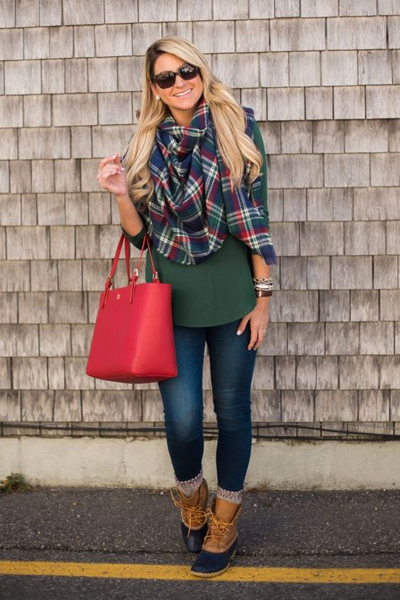 an emerald shirt, a plaid scarf, skinnies and brown booties
