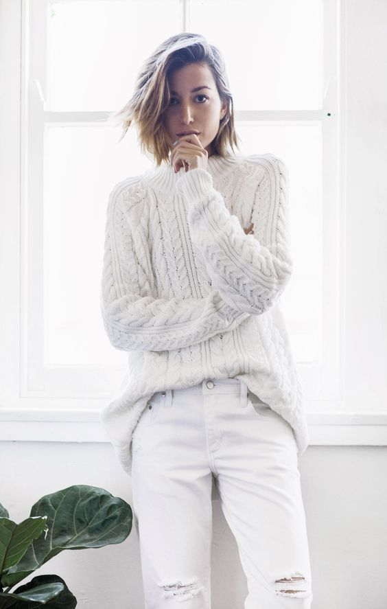 white distressed denim and a cable knit sweater for a comfy casual look