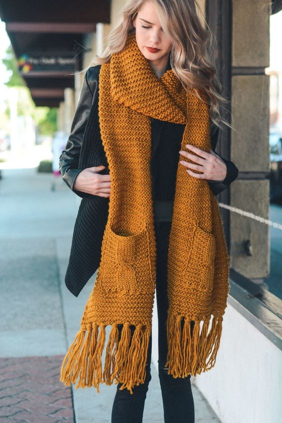 why not try a bold mustard scarf with pockets and tassels to stand out