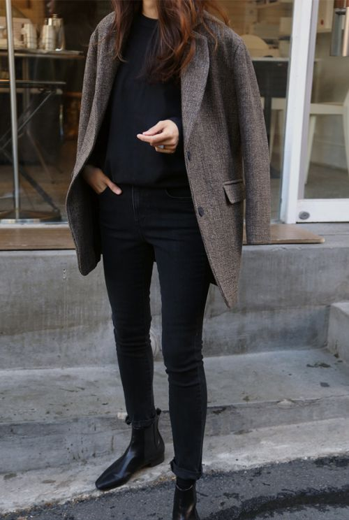 a black sweater, black jeans, a tweed jacket and black chelsea boots