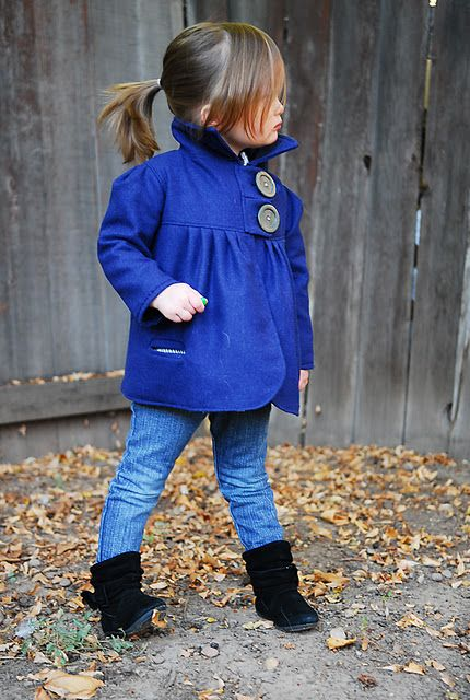 a chic modern coat in electric blue with two large buttons to make a statement