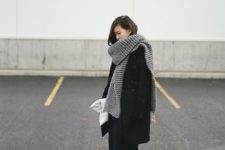 05 a grey chukny knit scarf worn over a black coat for a timeless look