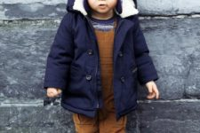 05 a navy boy's parka with white fur and a blue beanie