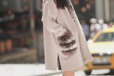 05 a pink coat with faux fur striped pockets to make it even more eye-catching
