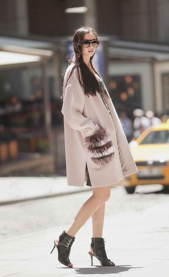 a pink coat with faux fur striped pockets to make it even more eye catching