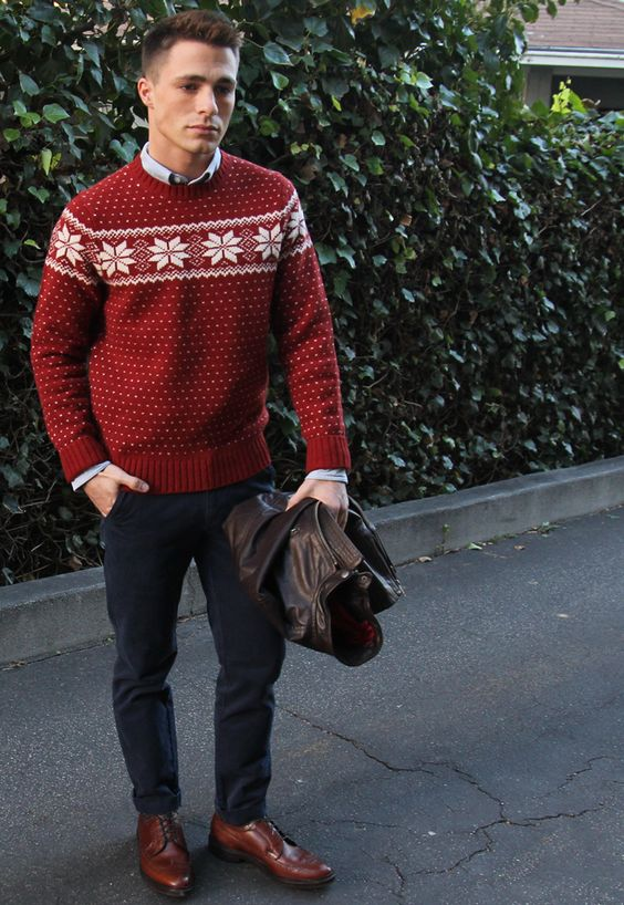 navy jeans, brown shoes, a blue shirt and a red printed sweater with a Christmas feel