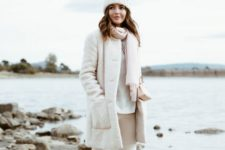 05 white jeans, a white sweater, coat and a beanie and a blush scarf and sneakers
