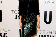 06 a black angora sweater, an emerald sequin skirt, black shoes and a Chanel bag