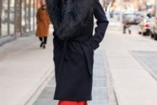 06 a black knee coat with a large faux fur stole for very cold winter days