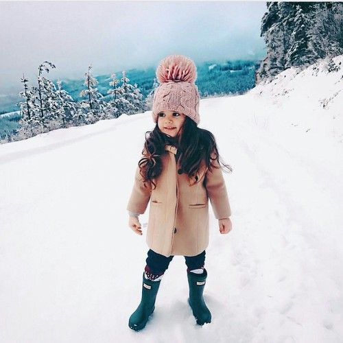 a blush coat and a pink beanie for a cute and girlish winter look