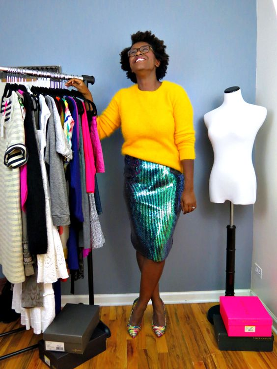 a colorful look with an emerald sequin skirt, a yellow angora sweater and colroful shoes