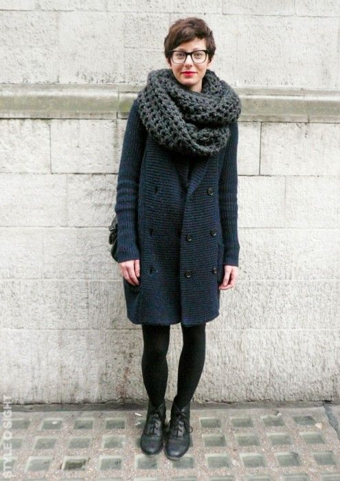 a navy textural coat and a black chunky knit scarf to feel cozy