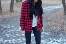 06 black leggings, a white tee, a plaid shirt, faux fur boots and a white beanie