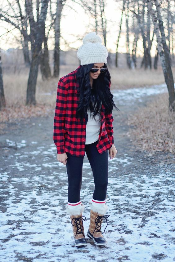 black leggings, a white tee, a plaid shirt, faux fur boots and a white beanie