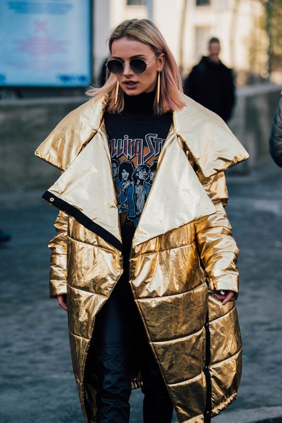 make a bold statement with a gold oversized puffer coat and a printed hoodie