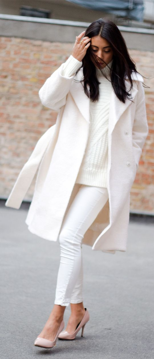 white jeans, a white chunky knit sweater, a white coat and blush heels