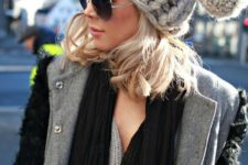 07 a chunky knit beanie with a yarn pompom for a bold look