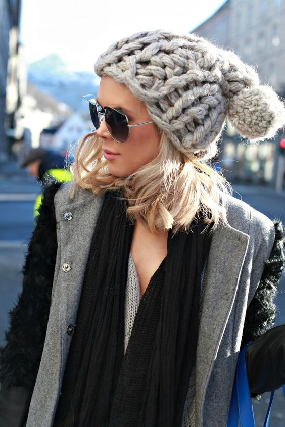 a chunky knit beanie with a yarn pompom for a bold look